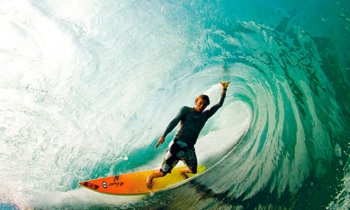 professional surfer riding waves