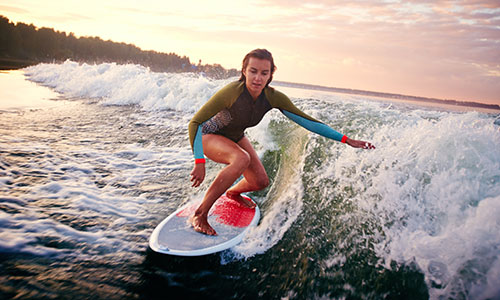 How to How to stand up on a surfboard